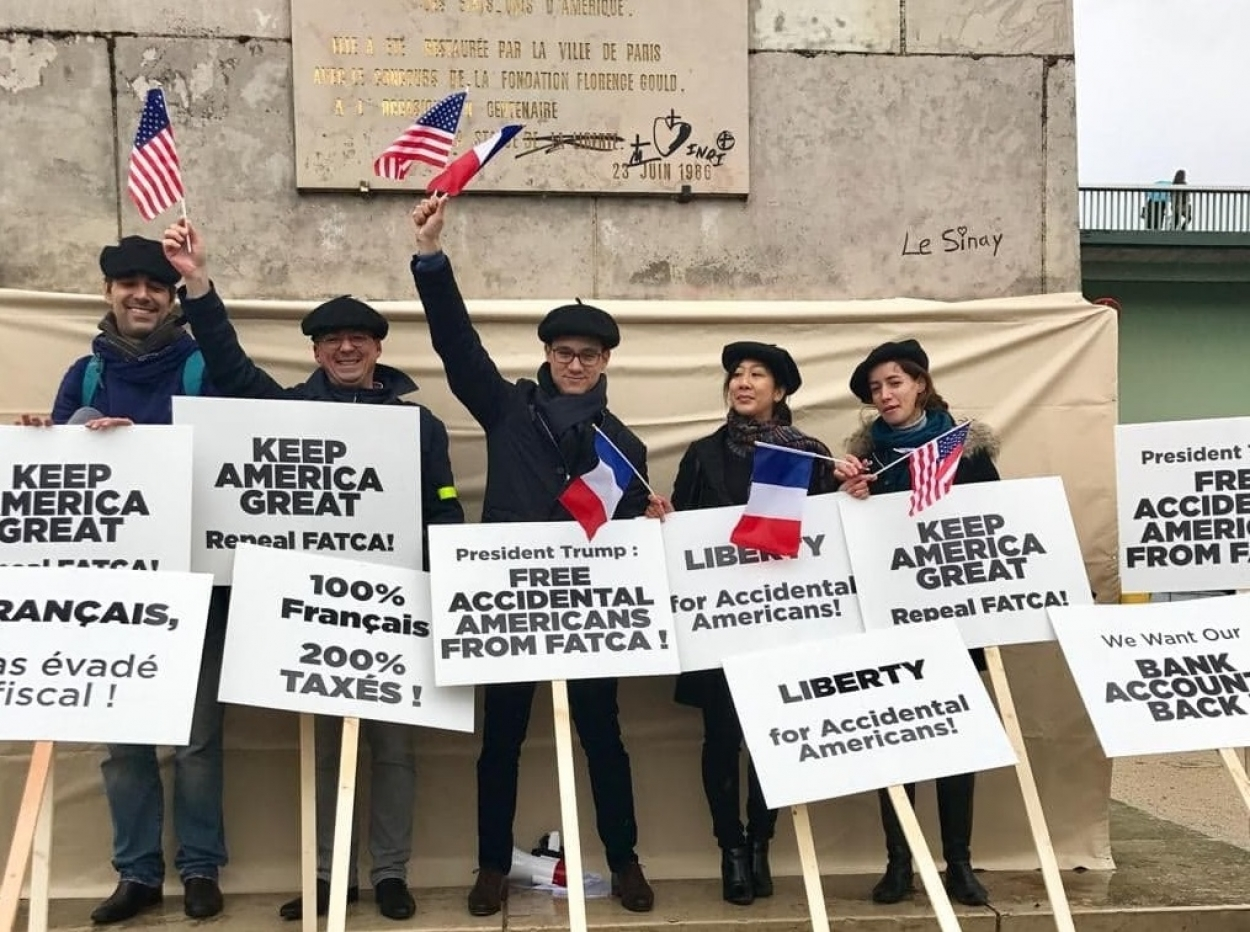 Above, Some of the more than 150 members of the Association of Accidental Americans who demonstrated on the Île aux Cygnes in Paris last November