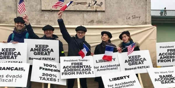 Fabien Lehagre, center, during a demonstration last November, beneath a a scale replica of the Statue of Liberty on the  Île aux Cygnes (Isle of Swans) in Paris